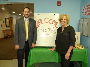 Sandi Camhi and Mike Matuszewski, Assistant Director of the Massapequa Library welcome Friends to the annual meeting.